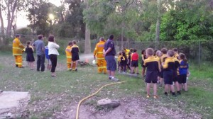 Pearl Beach RFS Extinguishing Fire in fire pit